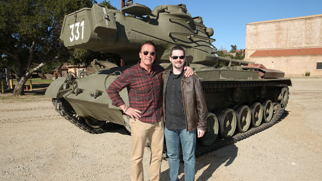 Arnold Schwarzenegger and Yahoo! Movies' Matt McDaniel (Photo: Eric Charbonneau)