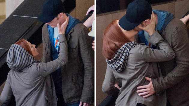 Scarlett Johansson and Chris Evans caught kissing on the set of 'Captiain America' ... in character (ISOIMAGES)