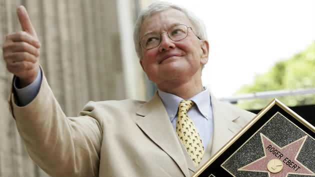 Roger Ebert gives the thumbs-up while receiving a star on the Hollywood Walk of Fame, June 23, 2005. Photo by Mario Anzuoni.