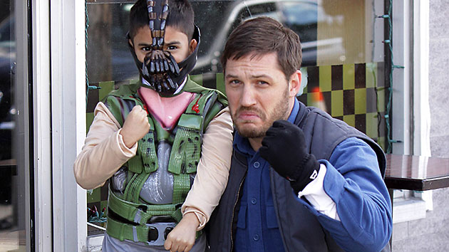 Tom Hardy, right, and a young fan in New York (Photo: Splash News)