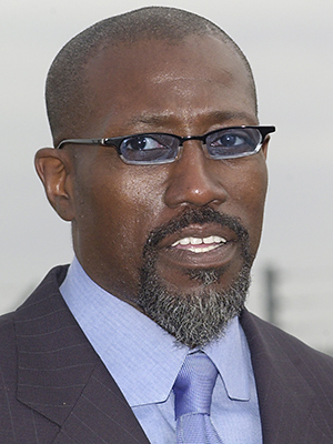 Wesley Snipes meets with a media gathering at Orlando International Airport Friday, Dec. 8, 2006, in Orlando, Fla. Snipes surrendered to authorities earlier in the day on tax fraud charges and was released on bail. (Peter Cosgrove/AP Photo)