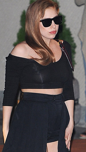 Gaga goes brunette. (Splash News)