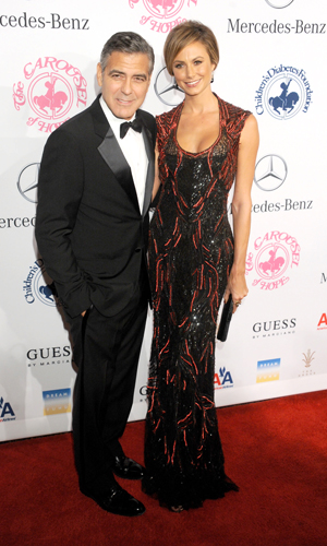 Stacy Keibler shows off her arm candy, George Clooney. (Gregg DeGuire/WireImage)
