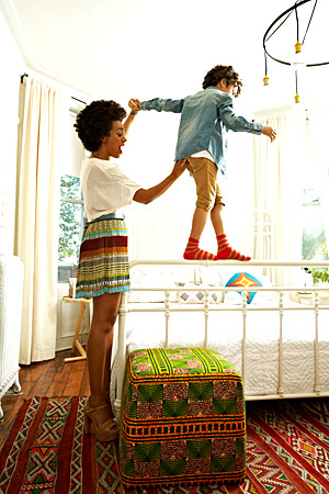 Solange Knowles and her son in her Brooklyn brownstone's bedroom. (Paul Costello/Elle)