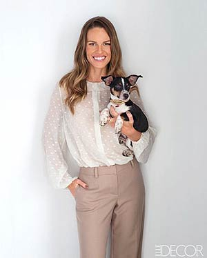 Hilary Swank hugs her dog, Kai. William Waldron