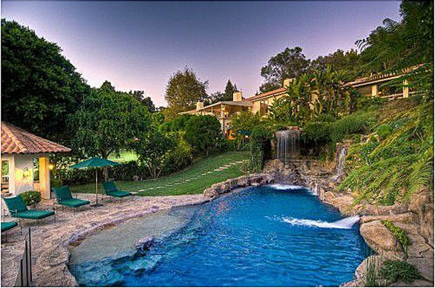 A waterfall pours into Mark Wahlberg's lagoon-like pool. (Zillow.com)