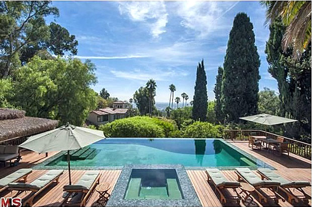 No, this isn't a hotel. It's the backyard pool. (Zillow)