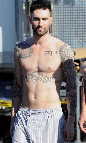 Maroon 5 frontman Adam Levine shows off his fit physique. - Whittle/Splash News