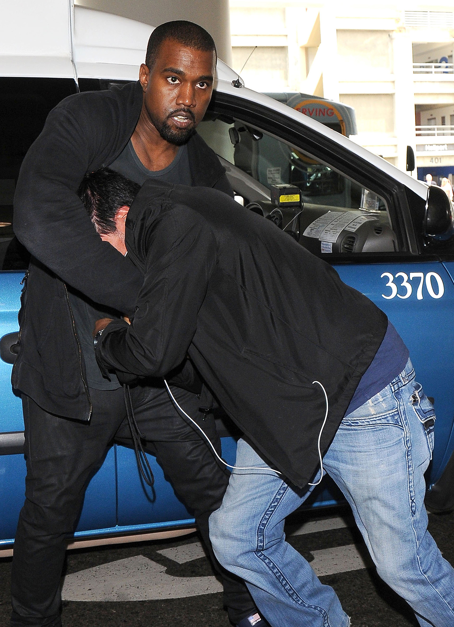 Kanye West's scuffle has led to a lawsuit. (FameFlynet)