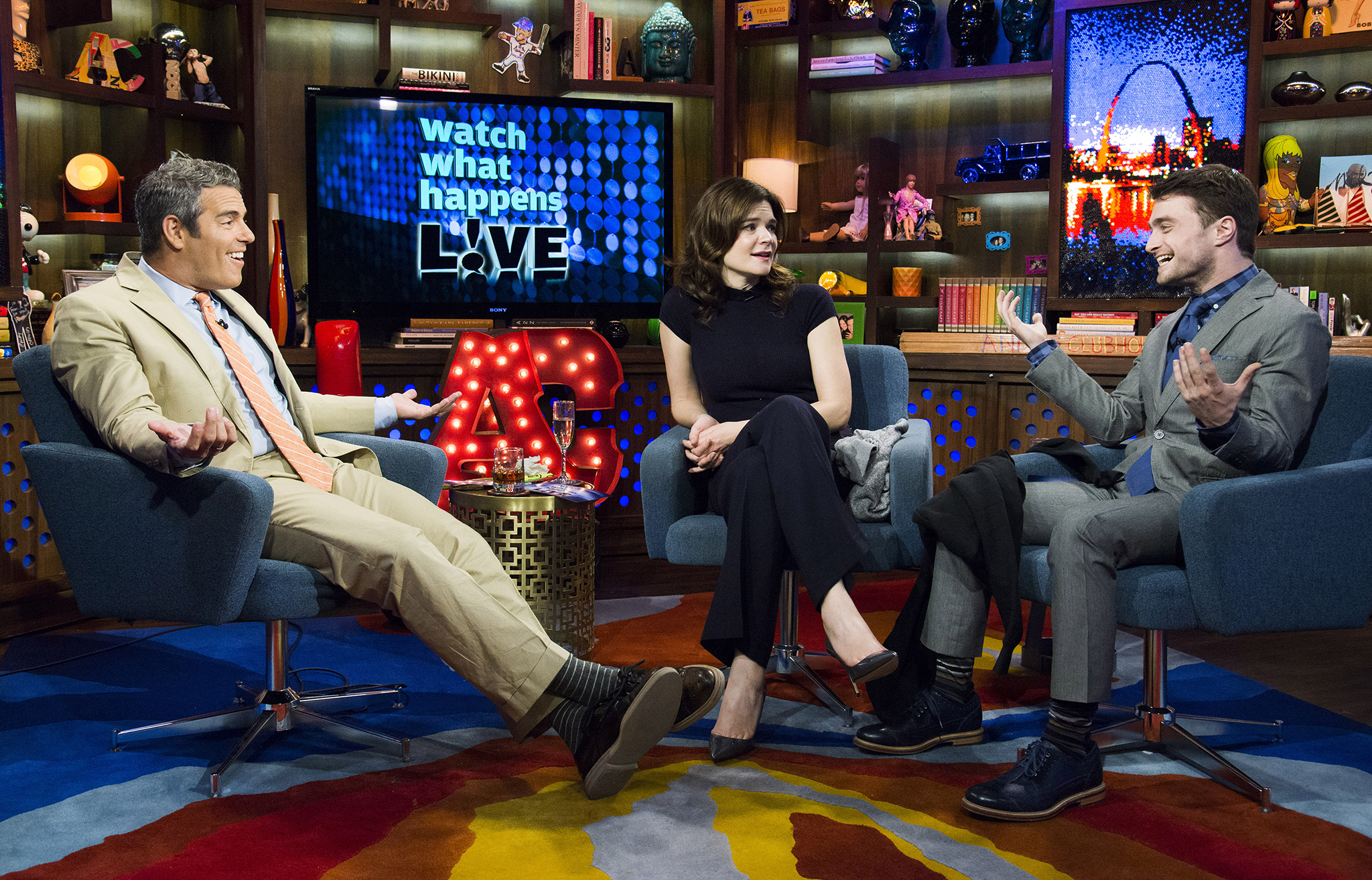 Daniel Radcliffe and Betsy Brandt join Andy Cohen on set (Charles Sykes/Bravo)
