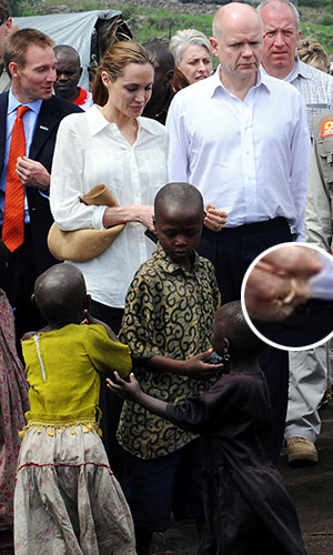 Jolie caused a stir when she donned a gold band. (CHP/FAMEFLYNET PICTURES)