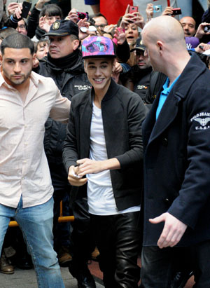 Justin Bieber was all smiles outside his hotel in Madrid on March 14. (Splash News)