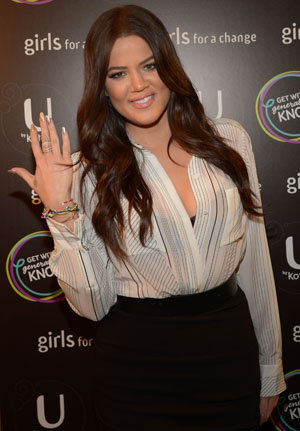 Khloe Kardashian showing off her 'Get With Generation Know' bracelet on January 30