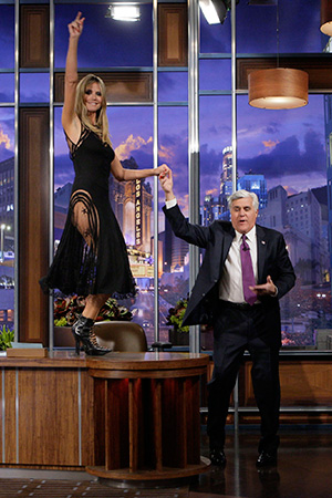 Heidi Klum on Jay Leno's desk (Getty Images)