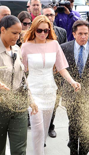 Lohan arrives late, gets glitter-bombed. (Splash News)