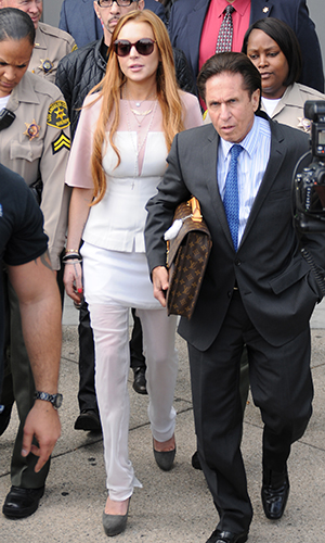 Lohan and her lawyer. (Splash News)