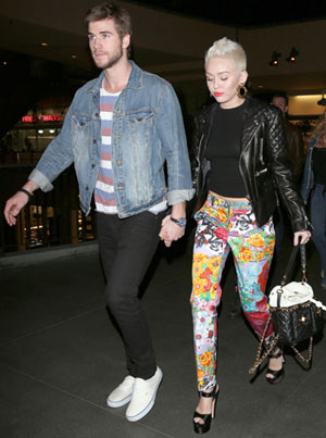 Liam Hemsworth and Miley Cyrus in January (PCN)