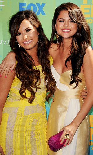 Demi Lovato and Selena Gomez in 2011 (Getty Images)