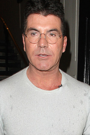 Simon Cowell in Harry Potter glasses (Splash News)