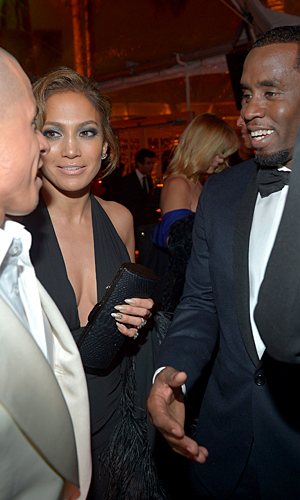 Lopez introducing her ex Diddy to her new beau, Casper Smart. (Getty Images)