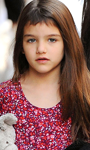 New year, new 'do: Suri recently debuted bangs, which she may have cut herself. (INF Daily)