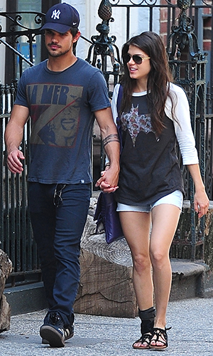Taylor Lautner and Marie Avgeropoulos have a hands-on relationship. (Alo Ceballos/FilmMagic)