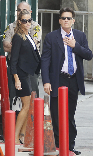 Denise Richards and Charlie Sheen leave court on May 7. (INFDaIly.com)