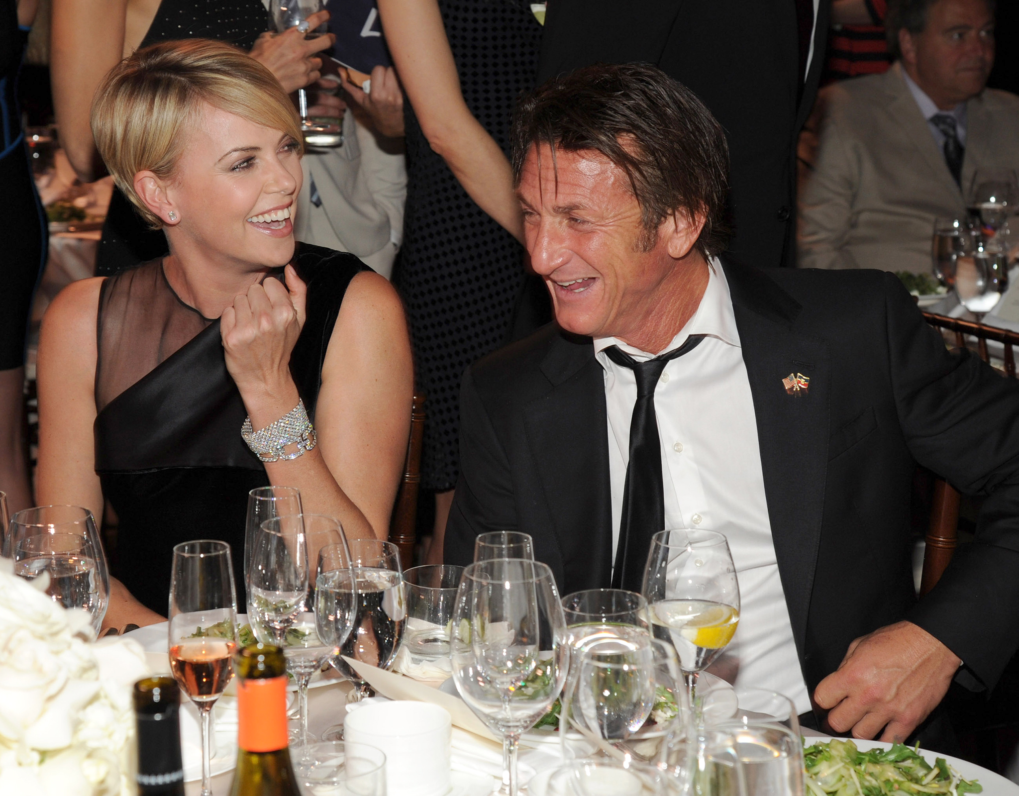 Sean Penn and Charlize Theron share a laugh together. (Getty Images)