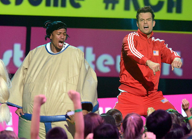 Nick Cannon and Josh Duhamel bust a move. (Getty Images)