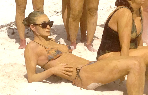 Demi Moore relaxes on the beach covered in mud (Coleman-Rayman)
