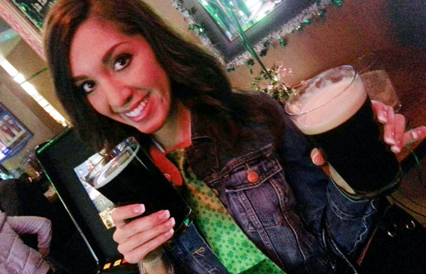 Farrah on St. Patrick's Day with not one, but two beers. (Xposurephotos.com)
