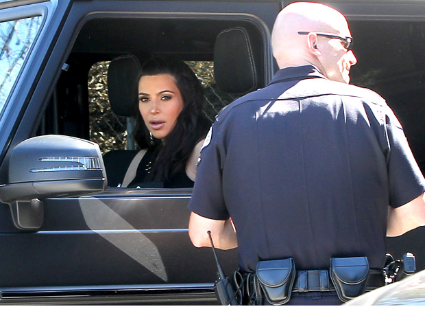 Kim Kardashian getting pulled over. (FameFlynet)