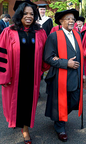 Oprah marches with her friend, Harvard professor Henry Louis Gates. (Paul Marotta/Getty Images)