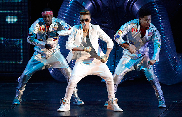 Justin Bieber and dancers at the O2 in London on Tuesday night (Getty Images)
