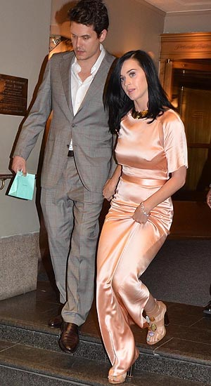 John Mayer and Katy Perry exit the Waldorf Astoria hand in hand (Landov)