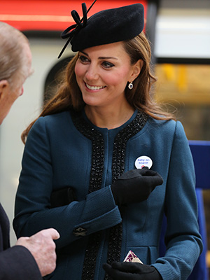 Kate Middleton accepts the pin (Getty Images)