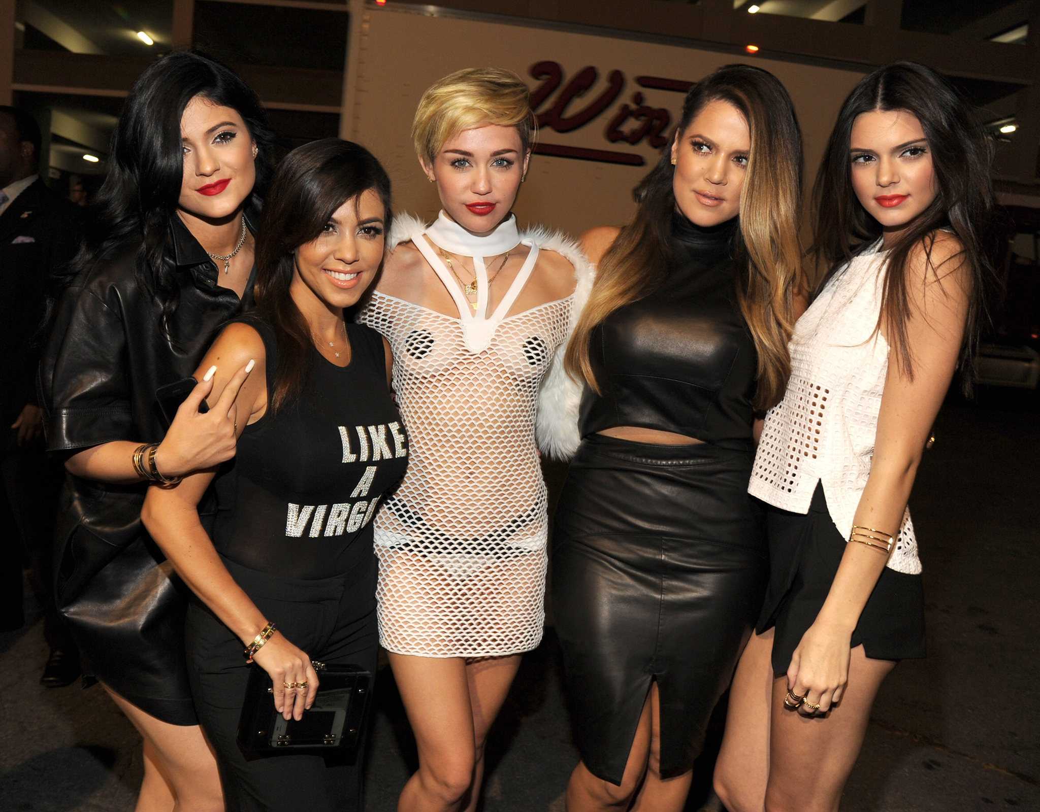 The Kardashian sisters pose with Miley Cyrus. (David Becker/Getty Images)