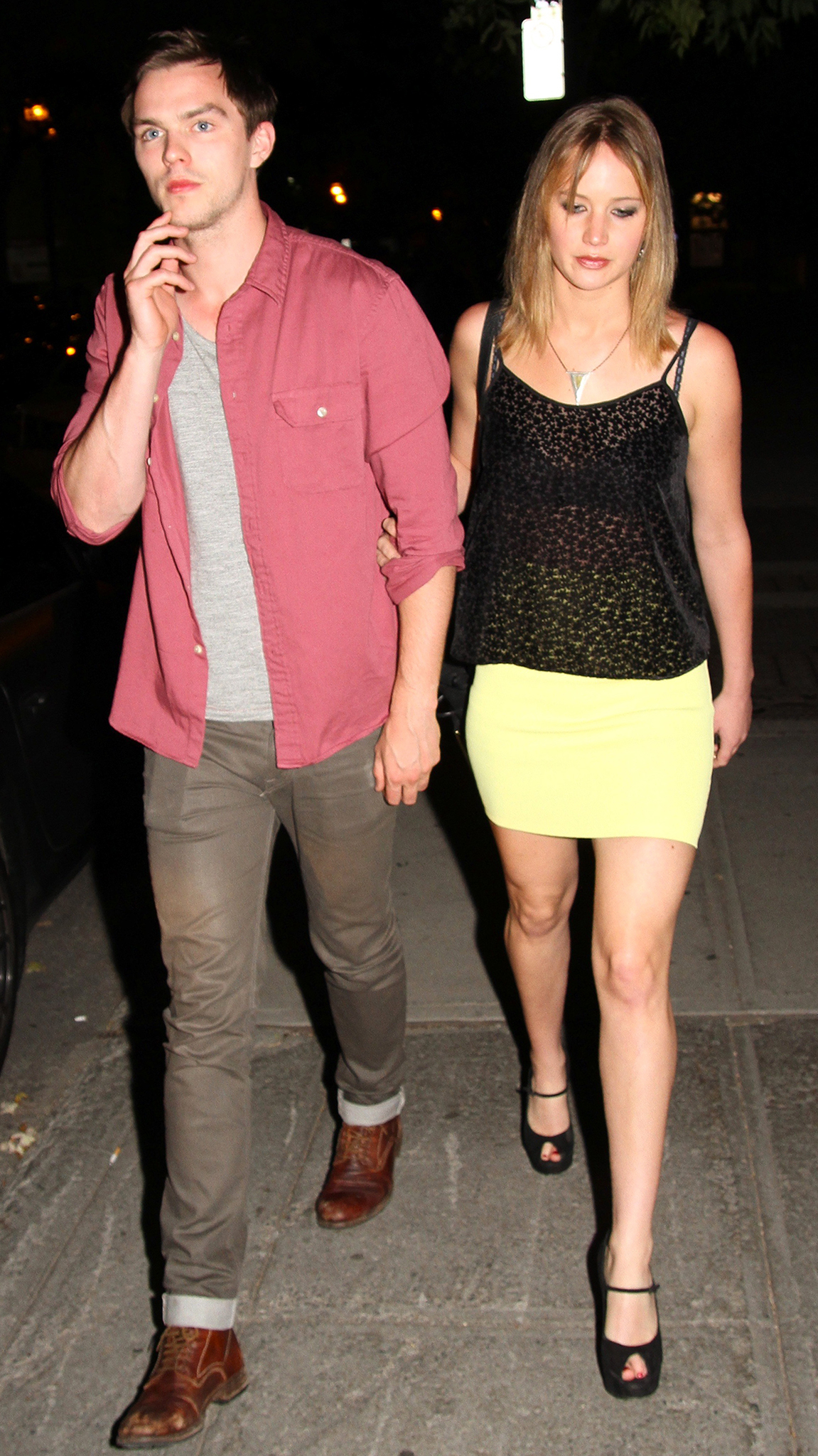 Nicholas Hoult and Jennifer Lawrence on Saturday night. (Splash News)