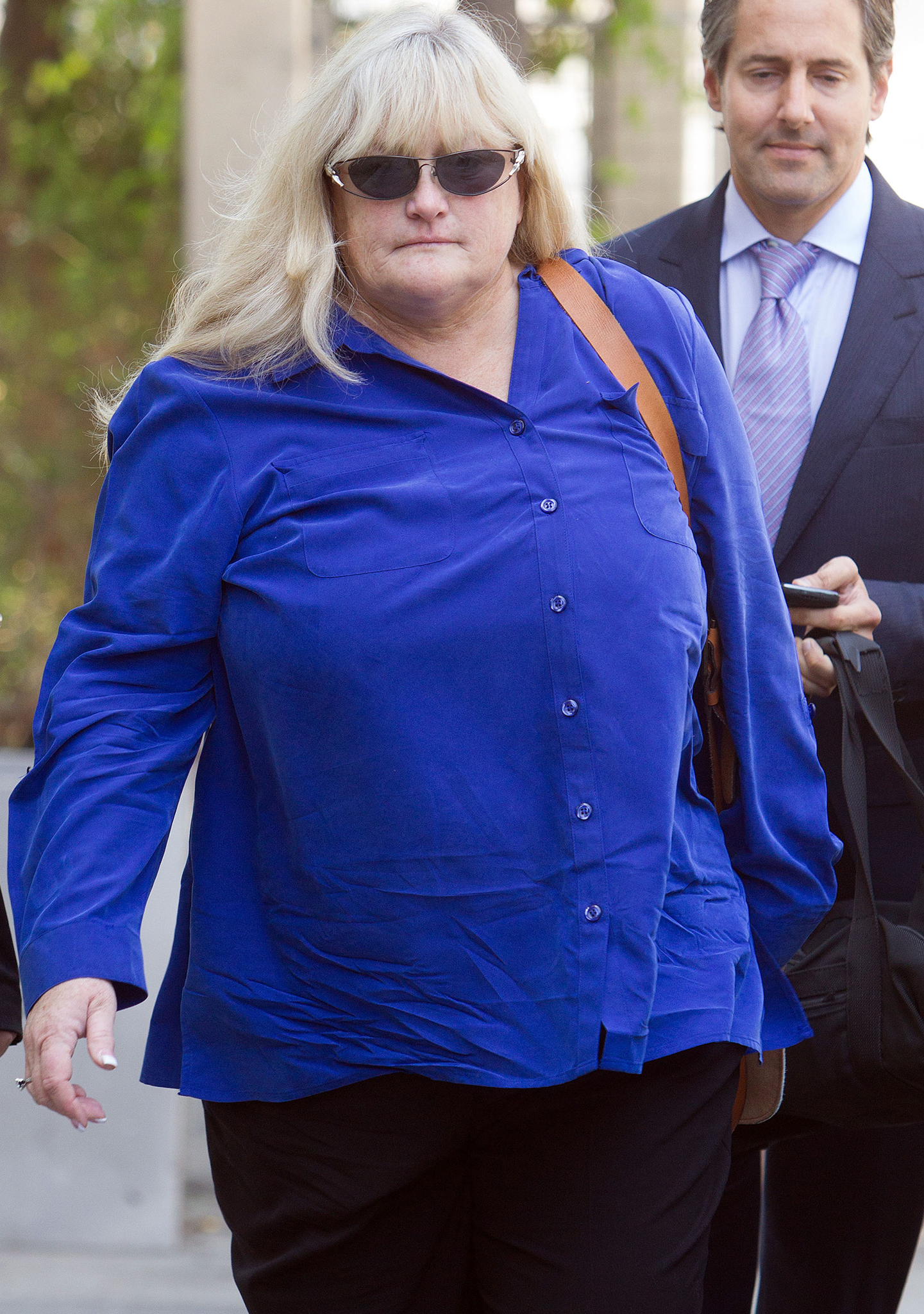 Debbie Rowe leaving court. (FameFlynet)