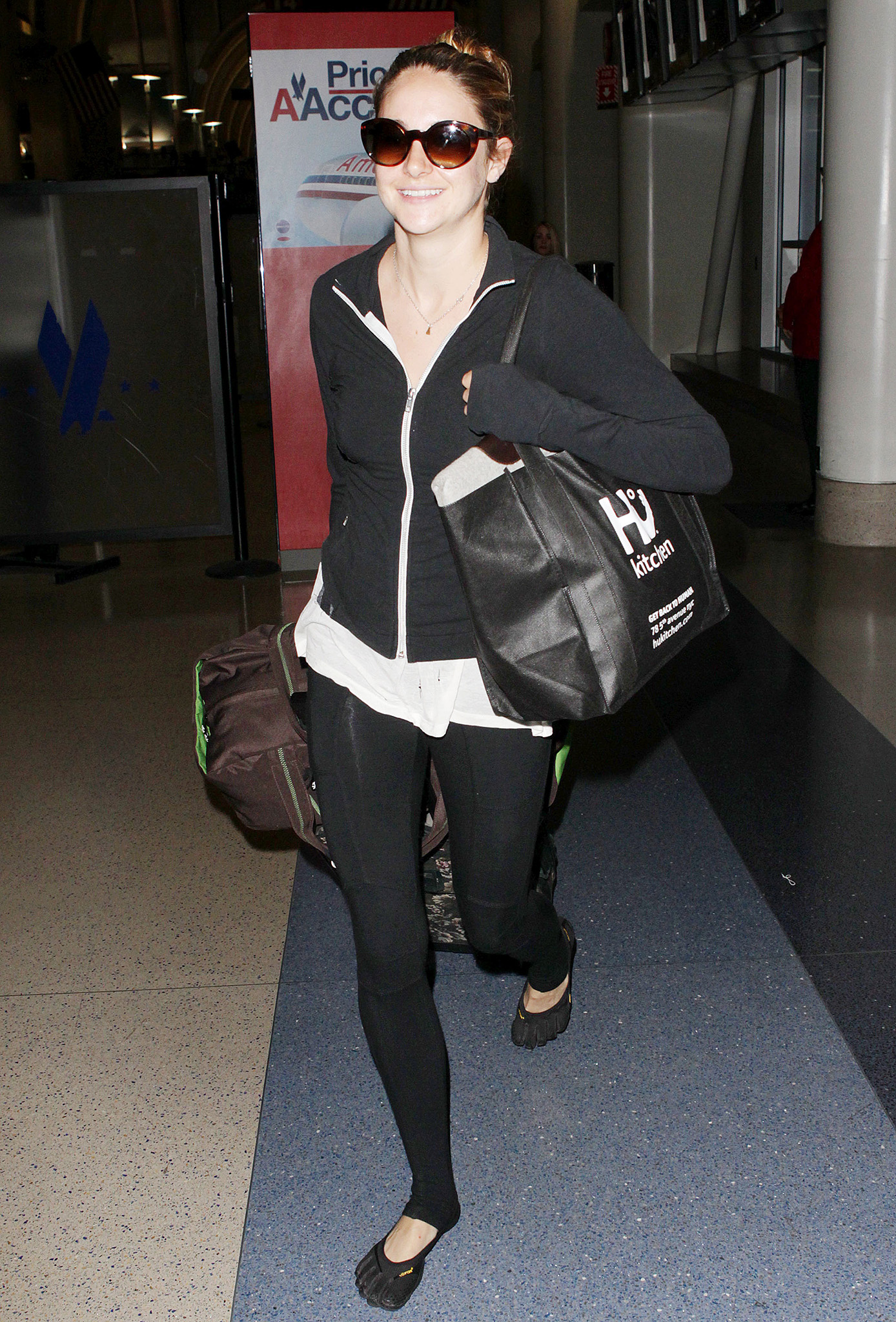 Woodley at the airport (Splash News)