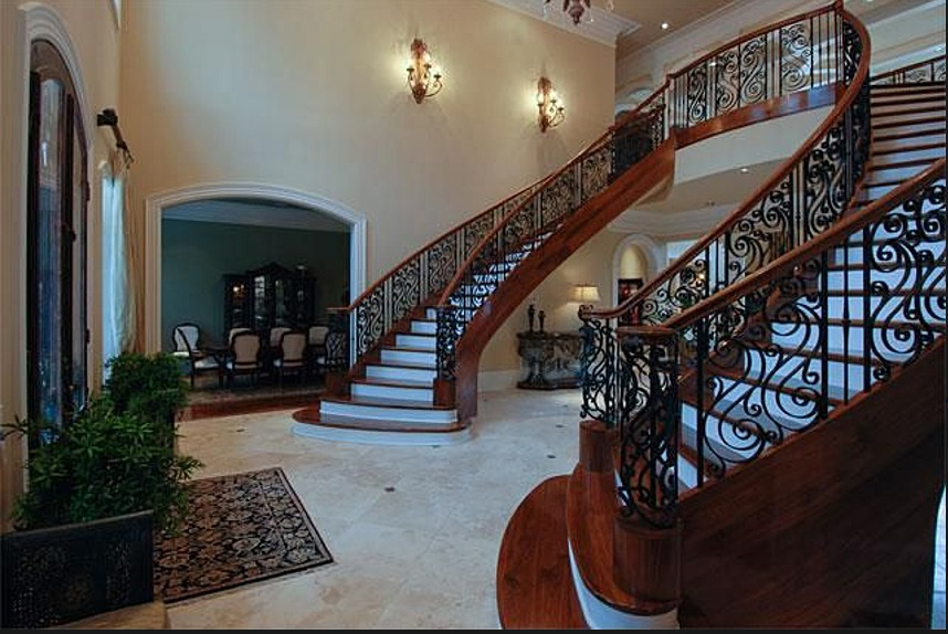 The entryway features a double staircase. (Zillow)