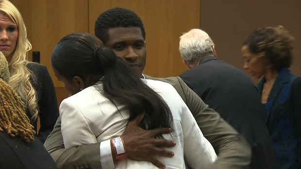 Usher and Tameka share a hug