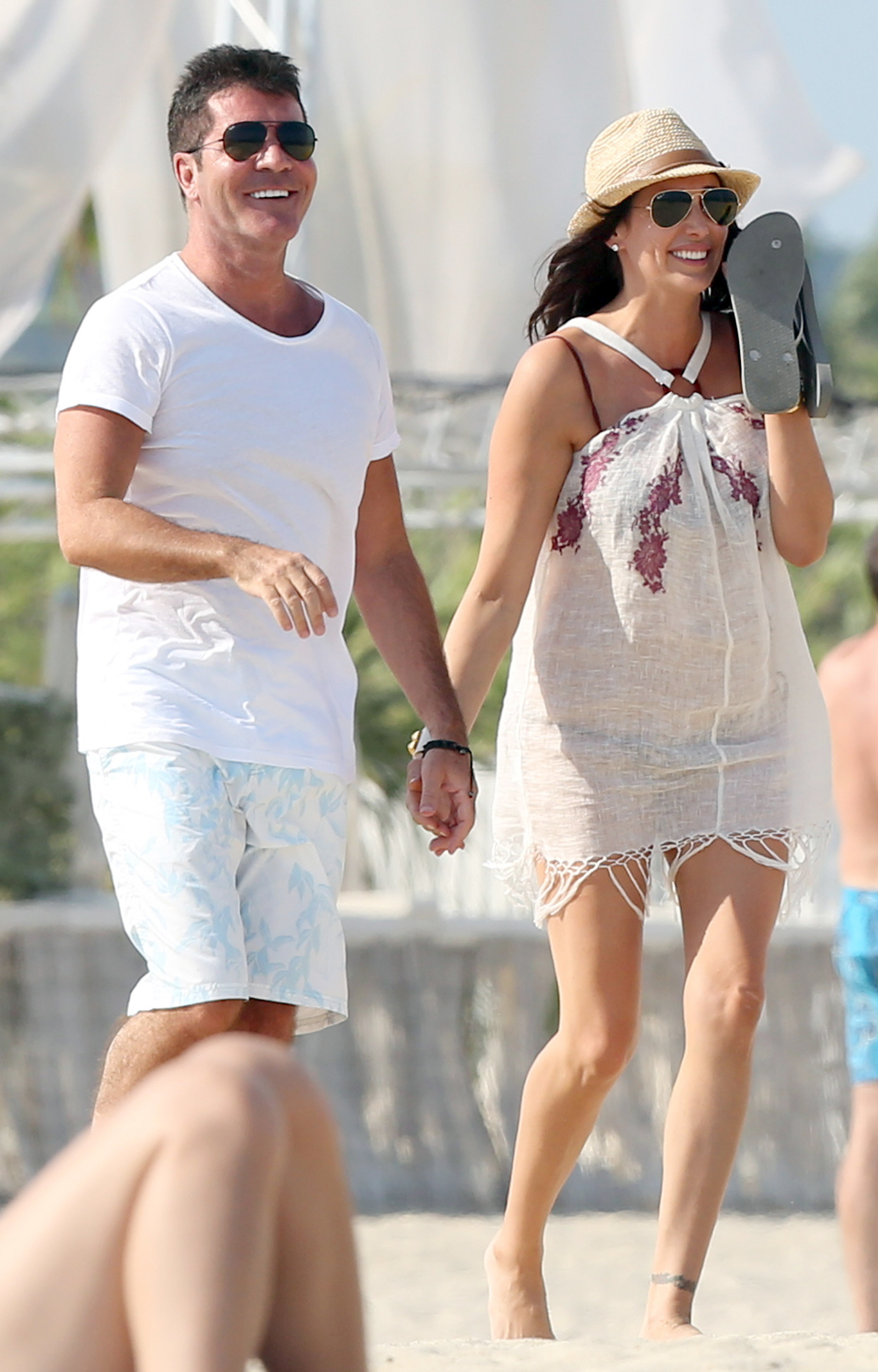 Simon Cowell and Lauren Silverman. (CHP/FAMEFLYNET)