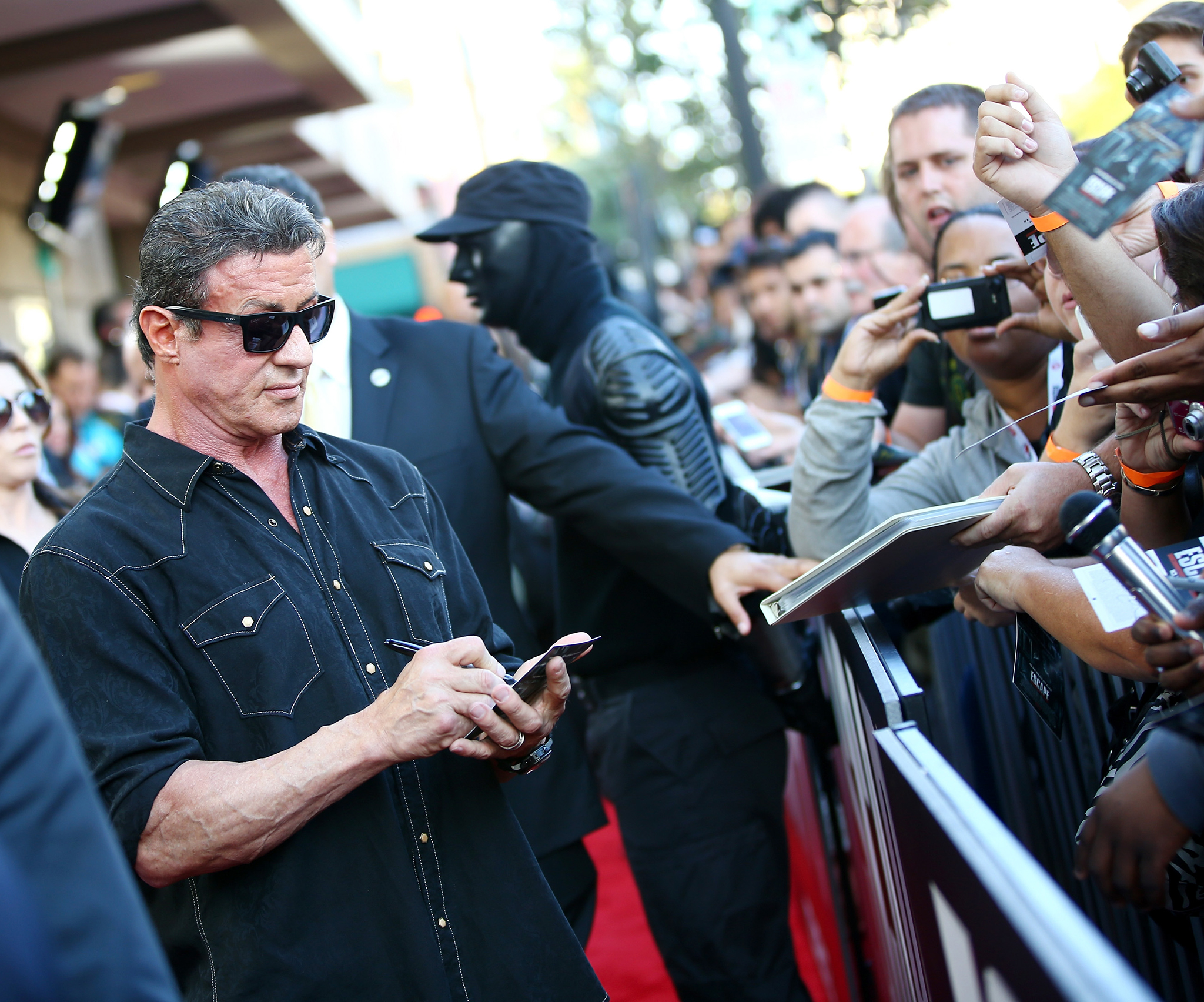 Sylvester Stallone charges for photos with fans. (Getty Images)