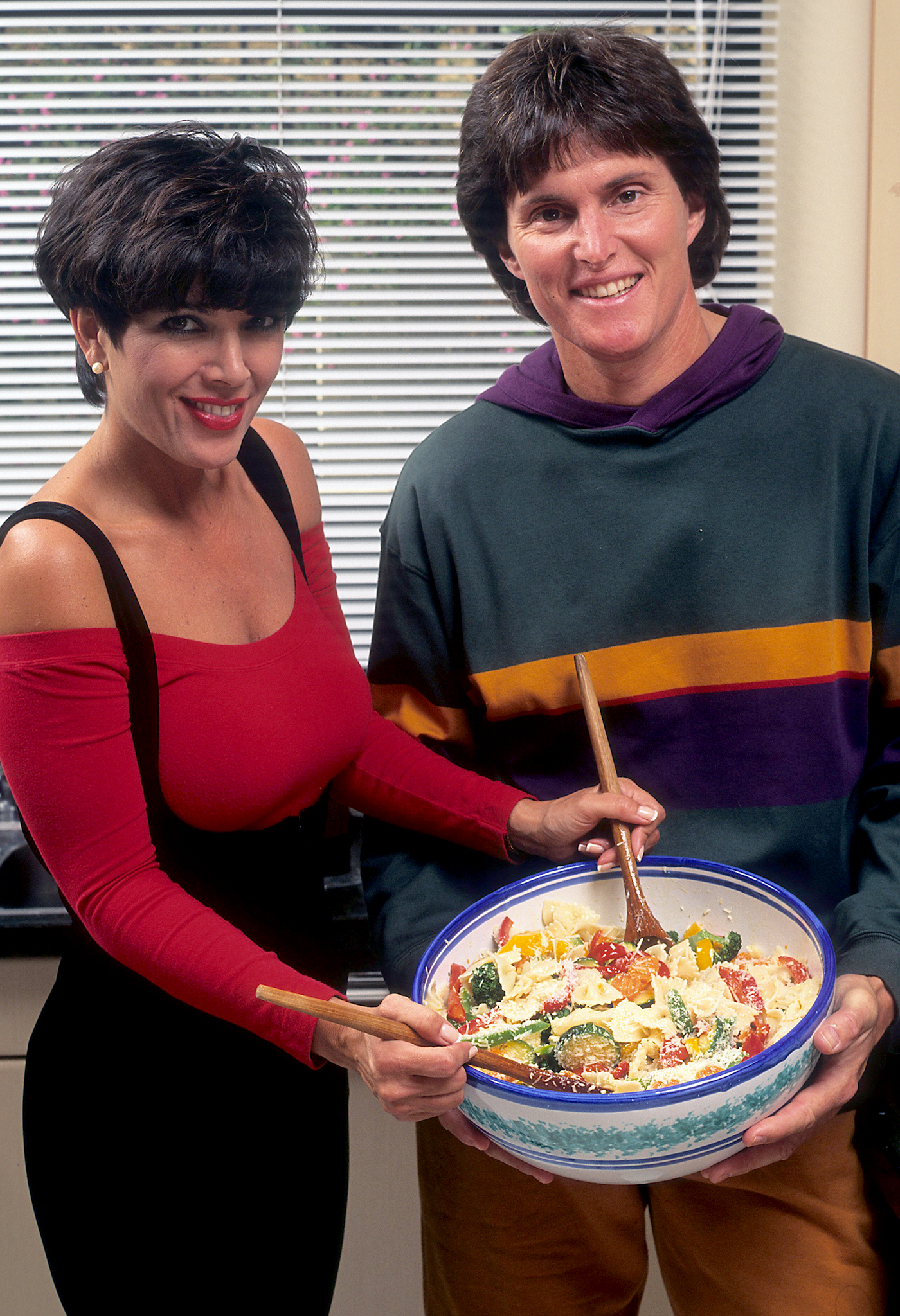 Kris and Bruce Jenner cook up some publicity in 1991. (Donaldson Collection/Getty Images)