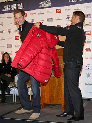 Prince Harry is given a team jacket by team leader Inge Solheim at the event launch (Danny Martindale/WireImage)