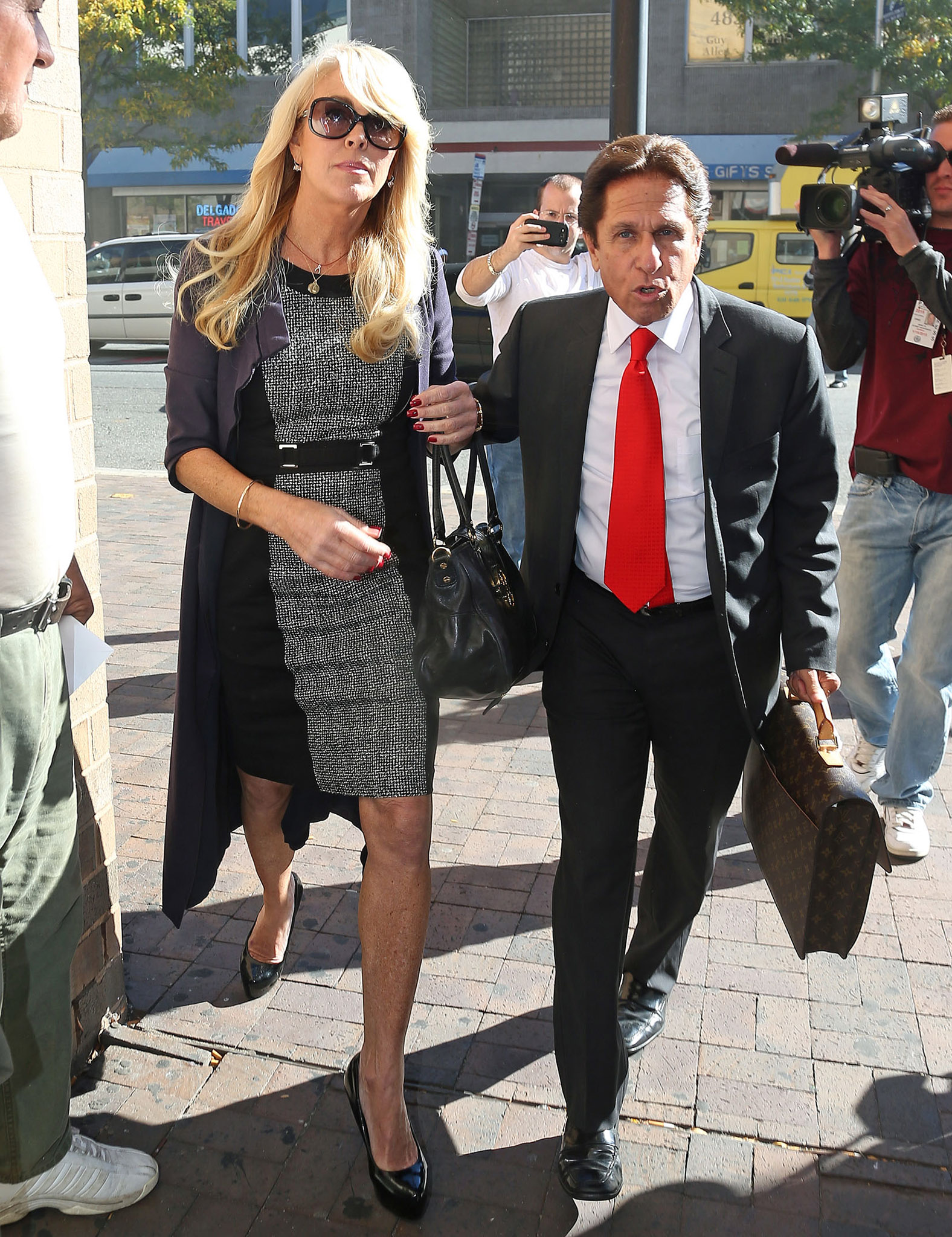 Dina Lohan and Mark Heller leave court Tuesday (Splash News)