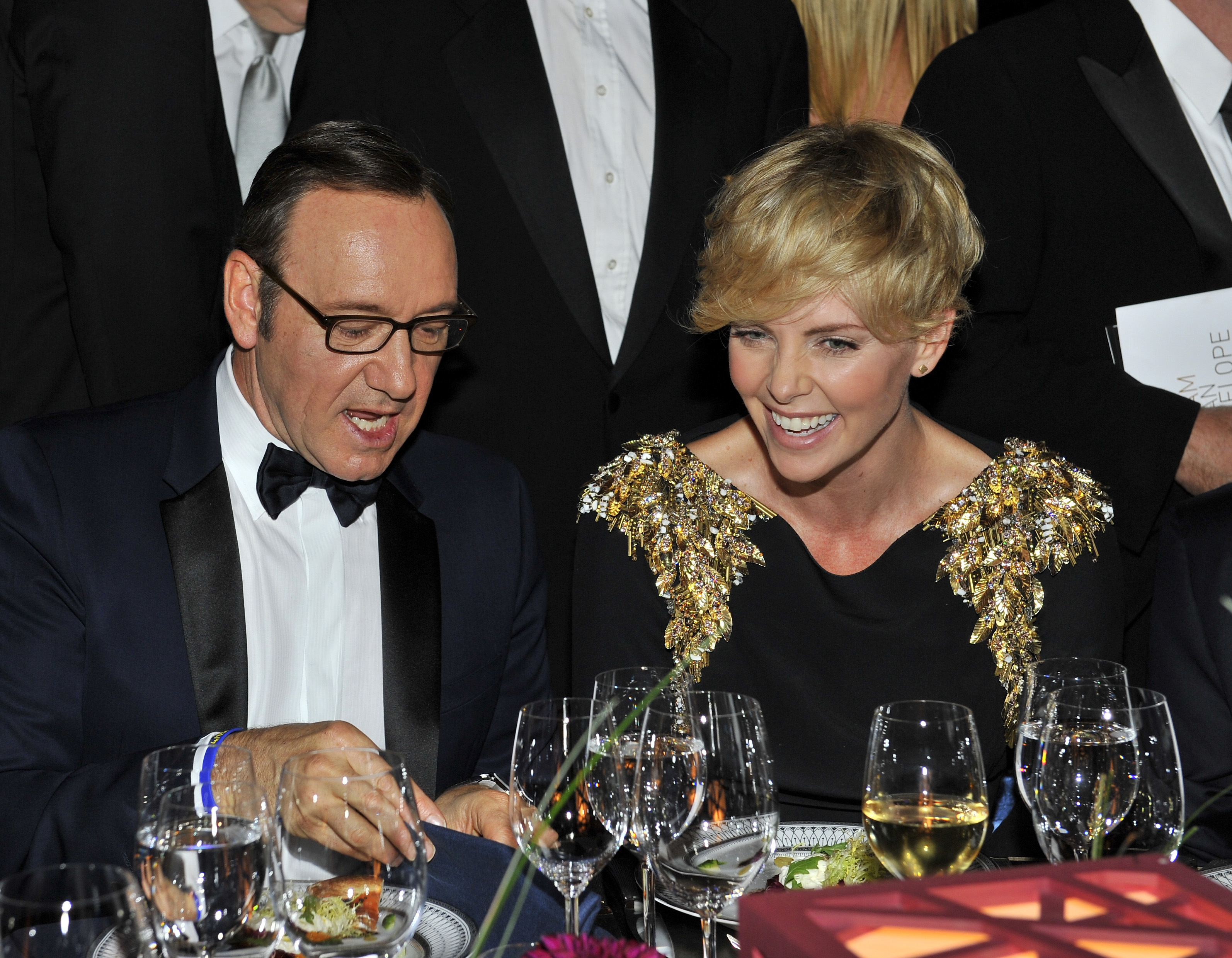 Kevin and Charlize share a laugh (Getty Images)