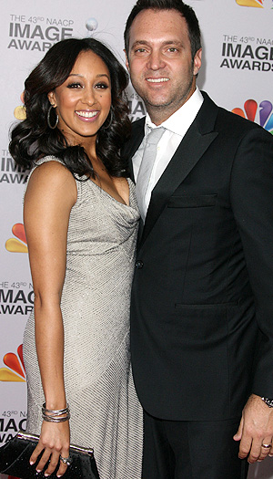 Tamera Mowry-Housley and husband (WireImage)