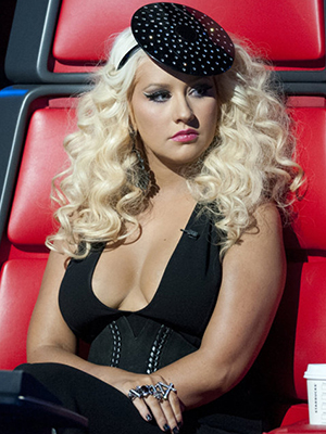 Aguilera's known for her attention-grabbing ensembles on the show... (NBC)